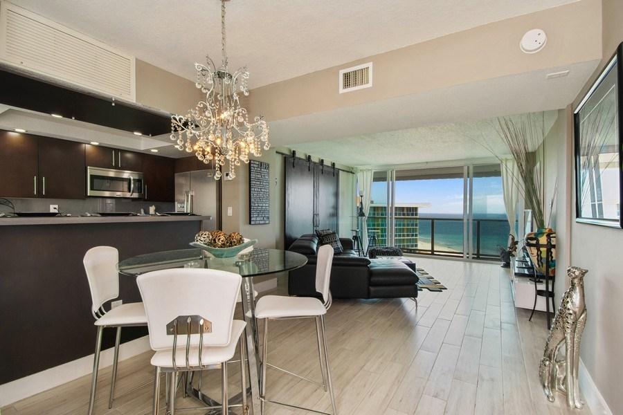 Real Estate Photography - Tiara East Condos, 333 NE 21st Ave #1802, Deerfield Beach, FL, 33441 - Living Room / Dining Room