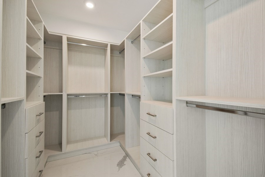 Real Estate Photography - 16901 Collins Ave., #702, Sunny Isles Beach, FL, 33160 - Master Bedroom Closet