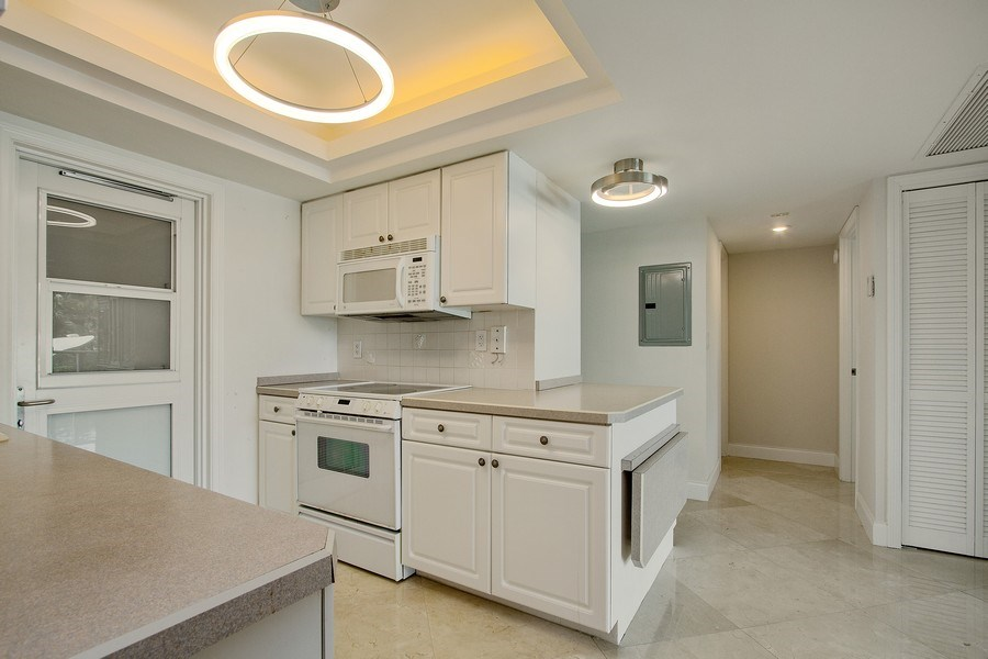 Real Estate Photography - Tiara East Condos333 NE 21st Ave., #310, Deerfield Beach, FL, 33441 - Kitchen
