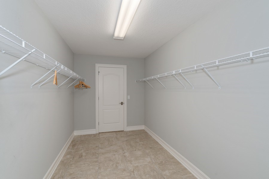 Real Estate Photography - 152 Mediterranean Way, Indian Harbour Beach, FL, 32937 - Master Bedroom Closet
