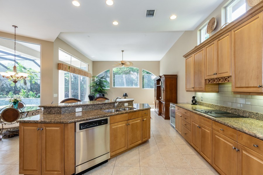 Real Estate Photography - 14530 Ocean Bluff Dr., Fort Myers, FL, 33908 - Family Room / Kitchen