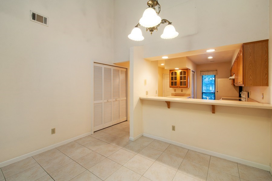 Real Estate Photography - 3931 NW 29 lane, Gainesville, FL, 32607 - Dining Area