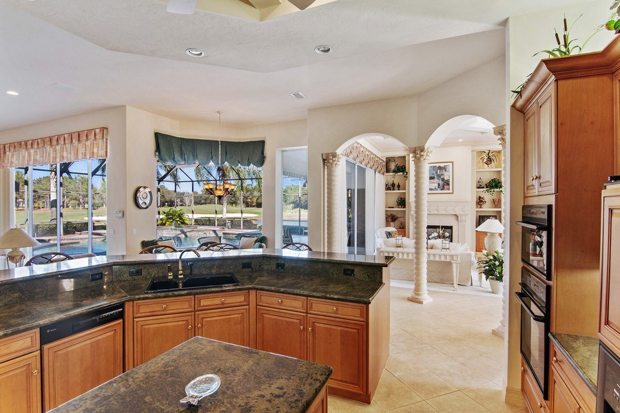Real Estate Photography - 7147 Beechmont Ter, Lakewood Ranch, FL, 34202 - Kitchen / Living Room