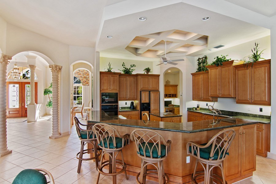 Real Estate Photography - 7147 Beechmont Ter, Lakewood Ranch, FL, 34202 - Kitchen / Dining Room
