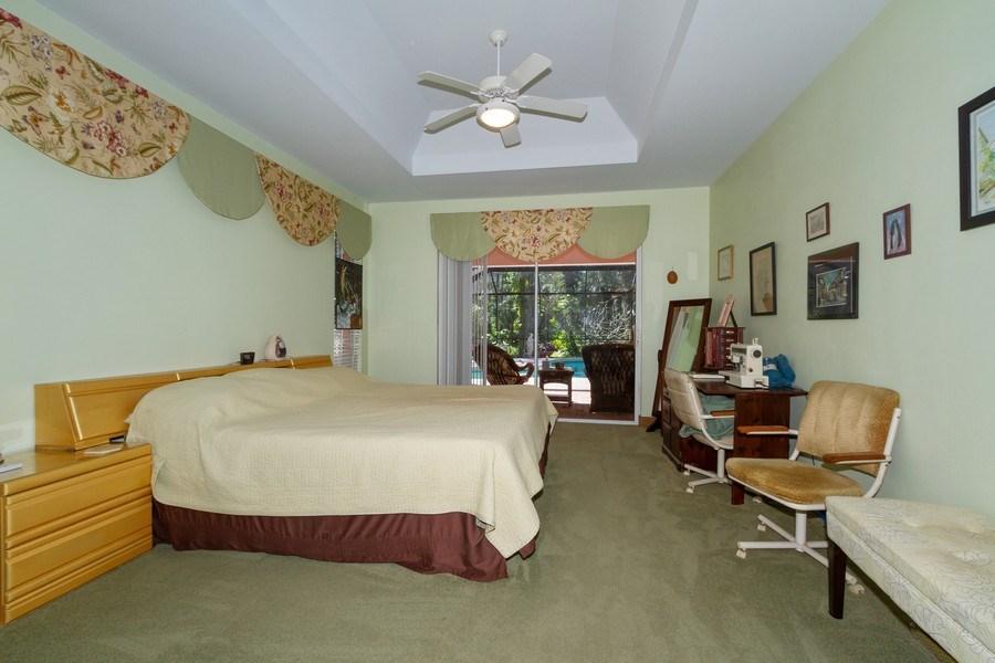 Real Estate Photography - 5180 Mahogany Ridge Drive, Naples, FL, 34119 - Master Bedroom