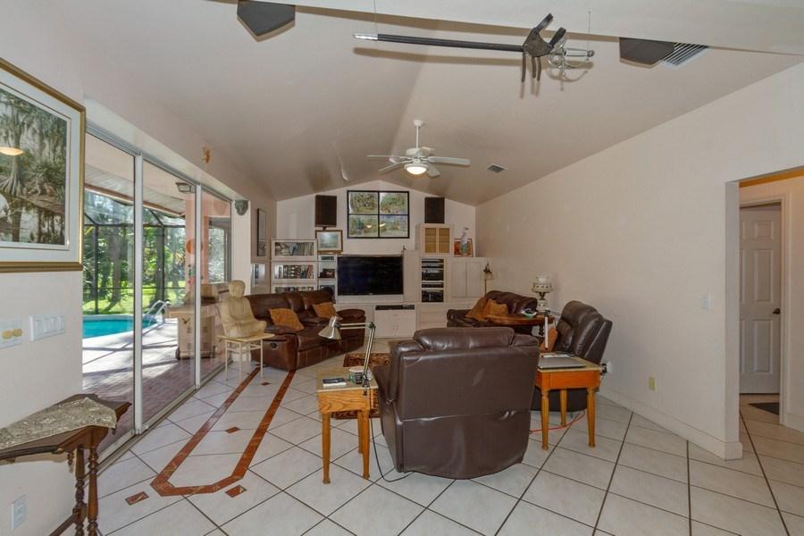 Real Estate Photography - 5180 Mahogany Ridge Drive, Naples, FL, 34119 - Family Room