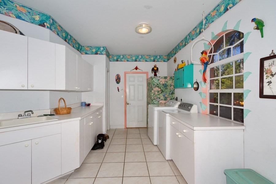 Real Estate Photography - 5180 Mahogany Ridge Drive, Naples, FL, 34119 - Laundry Room