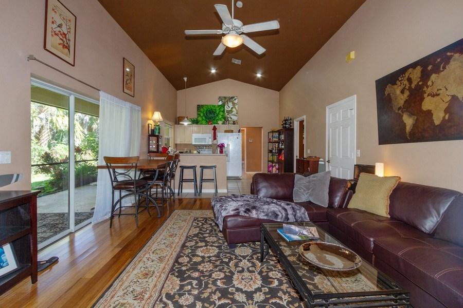 Real Estate Photography - 5180 Mahogany Ridge Drive, Naples, FL, 34119 - Guest House Living Room