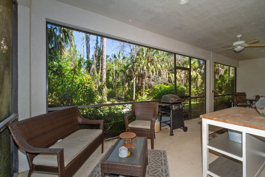 Real Estate Photography - 5180 Mahogany Ridge Drive, Naples, FL, 34119 - Guest Patio