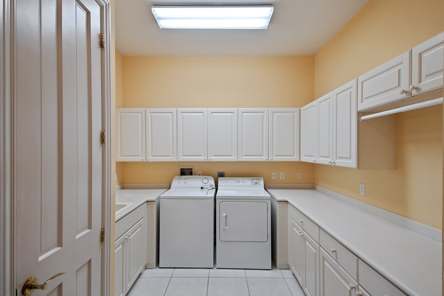 Real Estate Photography - 144 Cheshire Way, Naples, FL, 34110 - Laundry Room