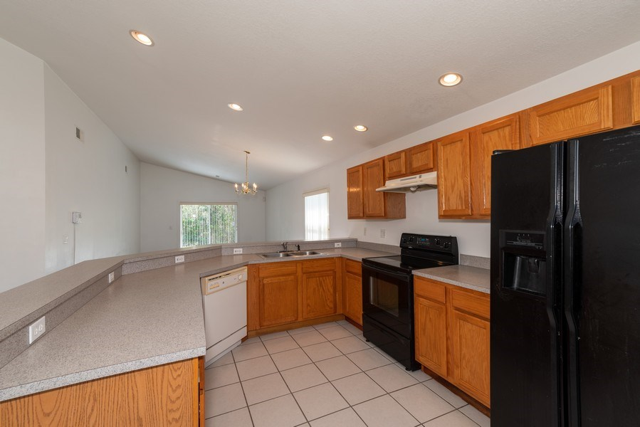 Real Estate Photography - 2456 Oak Mill Dr, Kissimmee, FL, 34744 - Kitchen