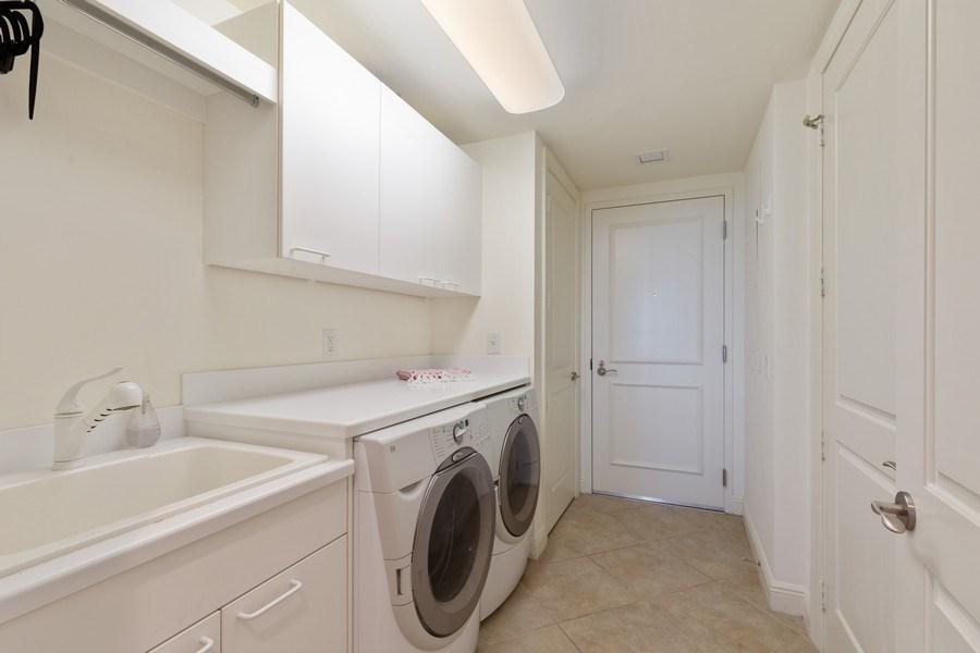 Real Estate Photography - 23850 Via Italia Cir, 502, Bonita Springs, FL, 34134 - Laundry Room