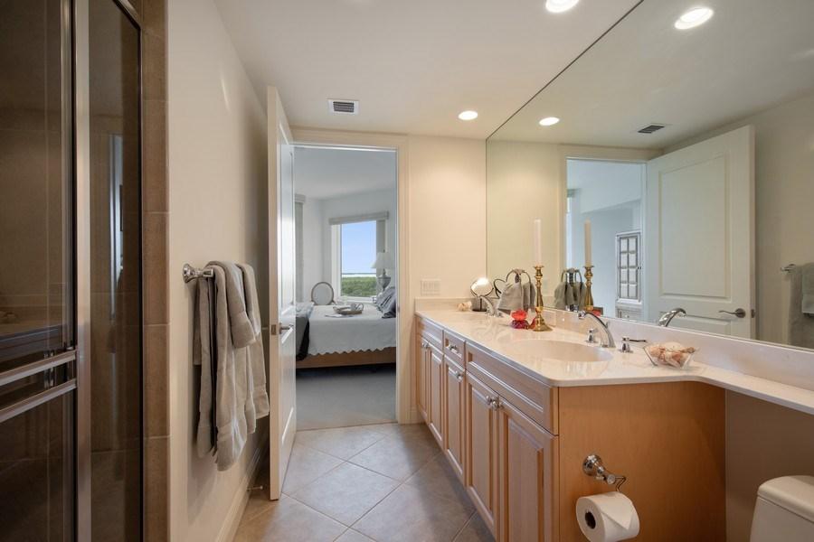 Real Estate Photography - 23850 Via Italia Cir, 502, Bonita Springs, FL, 34134 - Jack & Jill Bathroom
