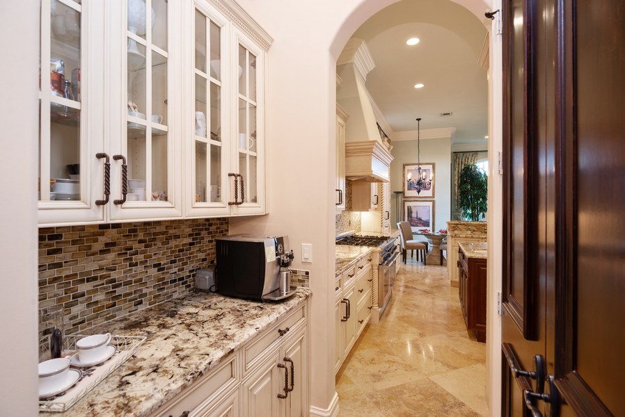 Real Estate Photography - 203 SE Bella Strano, Port St. Lucie, FL, 34984 - Butler's pantry
