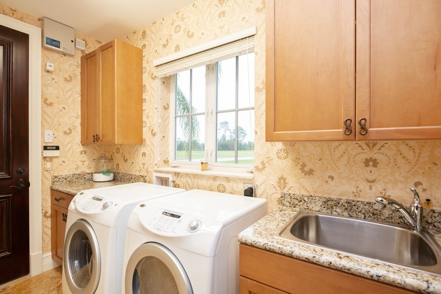 Real Estate Photography - 203 SE Bella Strano, Port St. Lucie, FL, 34984 - Laundry Room