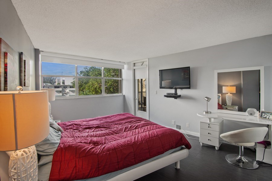 Real Estate Photography - 100 Golden Isles Drive #310, Hallandale Beach, FL, 33009 - Master Bedroom