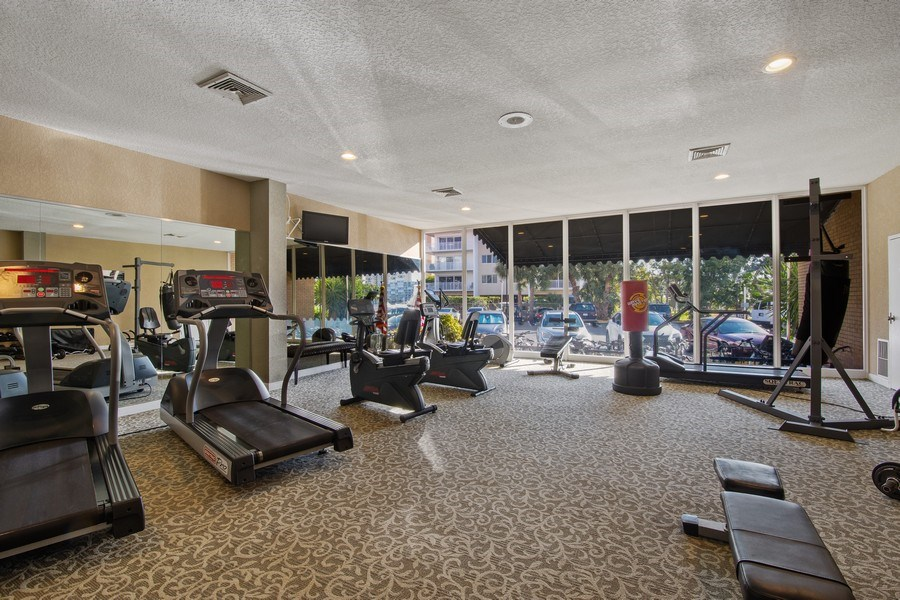 Real Estate Photography - 100 Golden Isles Drive #310, Hallandale Beach, FL, 33009 - Fitness Center