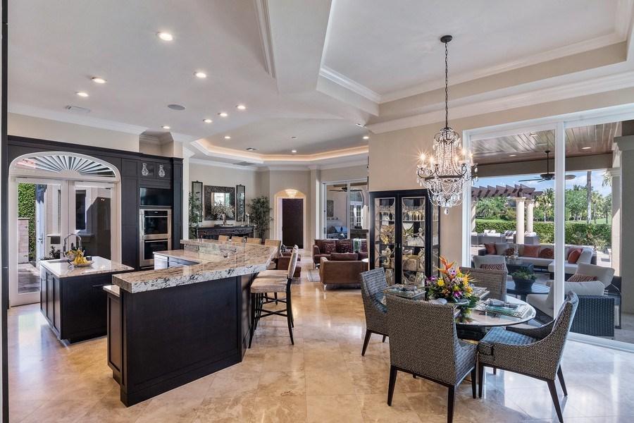 Real Estate Photography - 8732 Purslane Drive, Naples, FL, 34109 - Kitchen / Dining Room