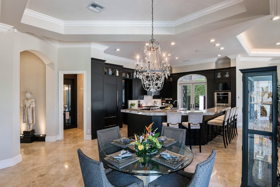 Real Estate Photography - 8732 Purslane Drive, Naples, FL, 34109 - Kitchen/Dining
