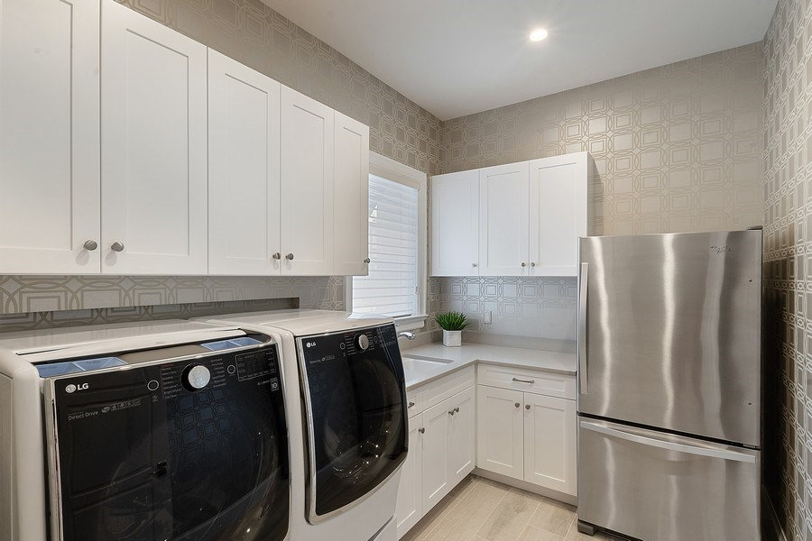 Real Estate Photography - 6888 Leeward Way, Naples, FL, 34109 - Laundry room doubles as Butler's Pantry with sink