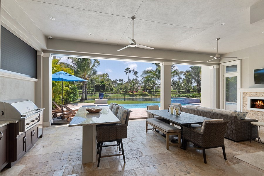 Real Estate Photography - 6888 Leeward Way, Naples, FL, 34109 - Notice the retractable screens & storm shutters