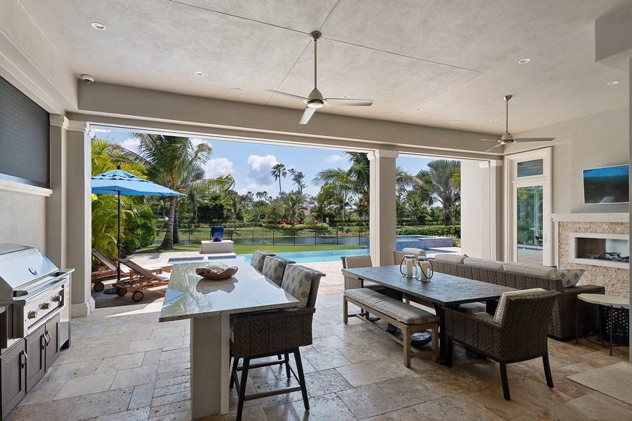 Real Estate Photography - 6888 Leeward Way, Naples, FL, 34109 - Plenty of seating areas to enjoy the peace