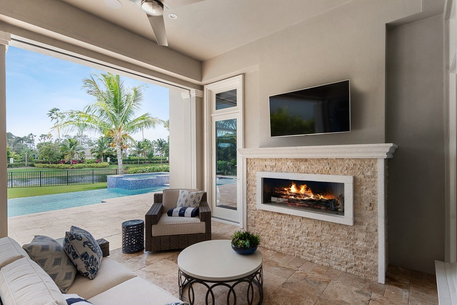 Real Estate Photography - 6888 Leeward Way, Naples, FL, 34109 - Cozy outdoor living just steps from your master