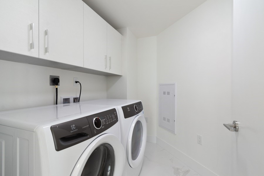 Real Estate Photography - 300 Sunny Isles Blvd., 802, Sunny Isles Beach, FL, 33160 - Laundry Room
