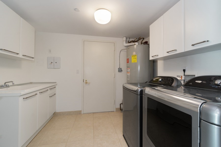 Real Estate Photography - 20155 NE 38th Court, #1401, Aventura, FL, 33180 - Laundry Room