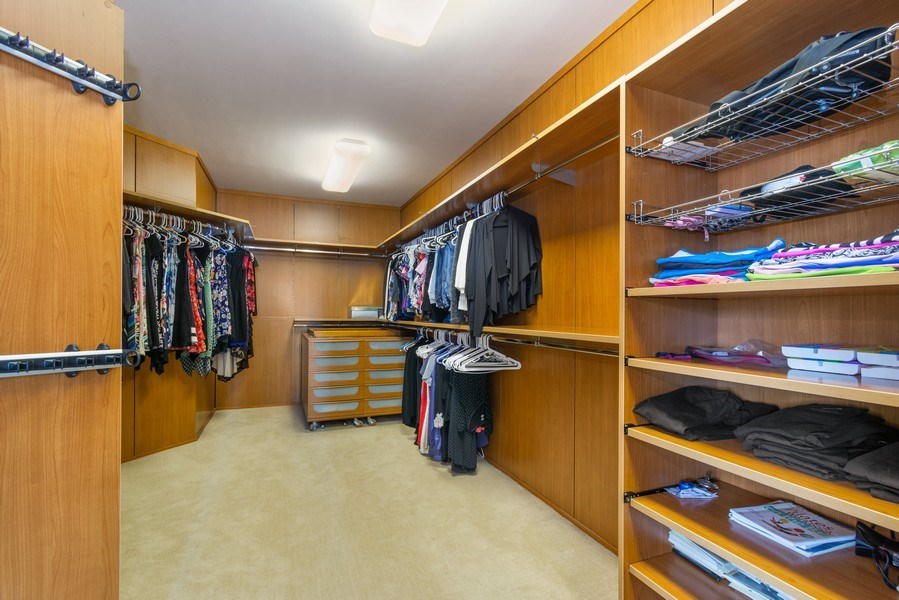 Real Estate Photography - 20155 NE 38th Court, #1401, Aventura, FL, 33180 - Master Bedroom Closet