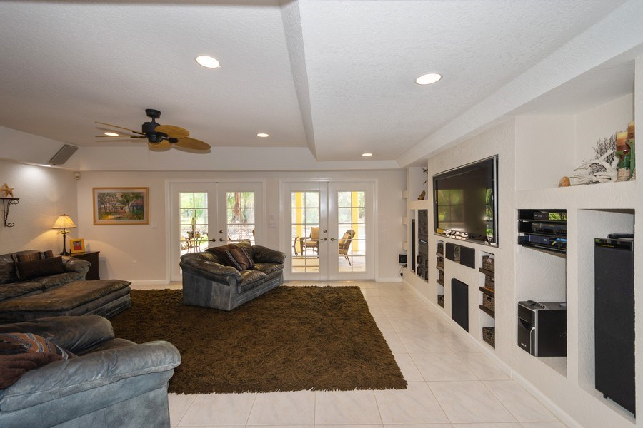 Real Estate Photography - 7250 NW 82nd Terrace, Parkland, FL, 33067 - Family Room
