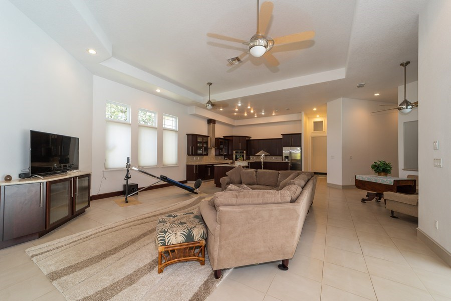 Real Estate Photography - 26052 Splendid Meadow Ct., Astatula, FL, 34705 - Family Room looking towards Kitchen and Breakfast