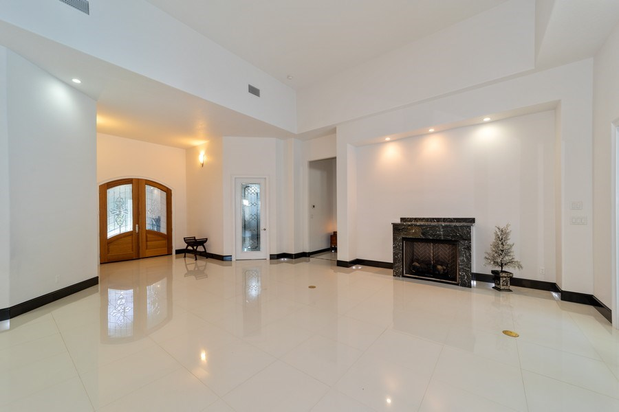 Real Estate Photography - 26052 Splendid Meadow Ct., Astatula, FL, 34705 - Living Room looking towards Front Entrance, Dining
