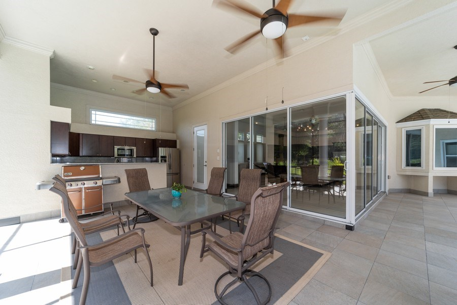 Real Estate Photography - 26052 Splendid Meadow Ct., Astatula, FL, 34705 - Rear Patio and Outside Kitchen