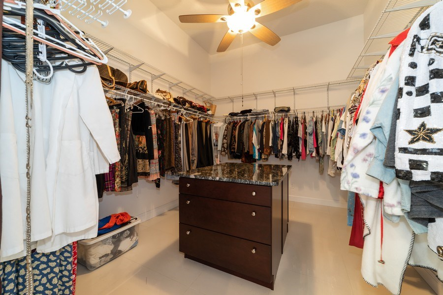 Real Estate Photography - 26052 Splendid Meadow Ct., Astatula, FL, 34705 - One of the His and Hers Closets in Master Bedroom