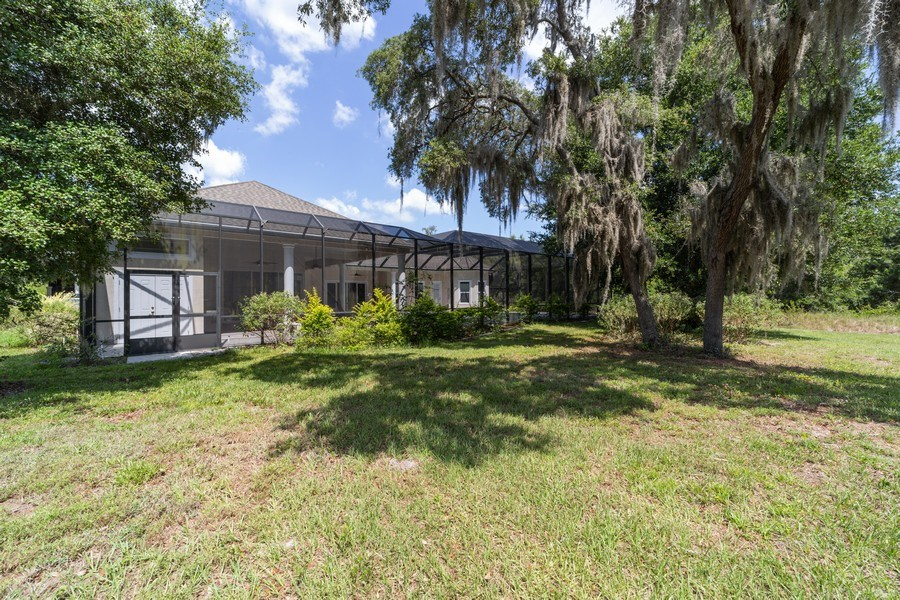 Real Estate Photography - 26052 Splendid Meadow Ct., Astatula, FL, 34705 - Rear View