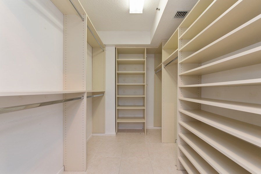 Real Estate Photography - 12529 Imperial Isle, Apt 207, Boynton Beach, FL, 33437 - Master Bedroom Closet