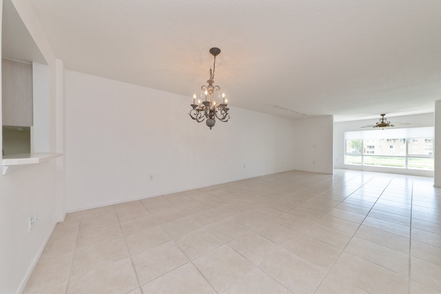 Real Estate Photography - 12529 Imperial Isle, Apt 207, Boynton Beach, FL, 33437 - Living Room / Dining Room