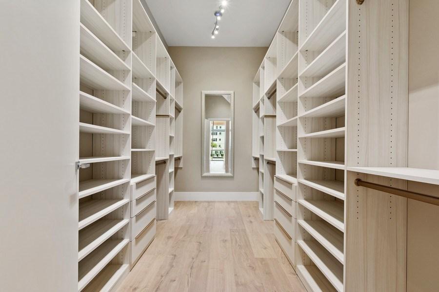 Real Estate Photography - 3250 NE 188th St. #L107, Aventura, FL, 33180 - Master Bedroom Closet