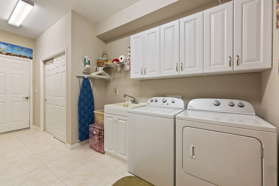 Real Estate Photography - 10736 Cetrella Dr, Fort Myers, FL, 33913 - Laundry Room