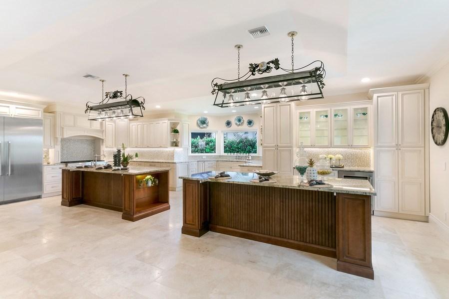 Real Estate Photography - 6840 SE South Marina Way, Stuart, FL, 34996 - Kitchen Islands