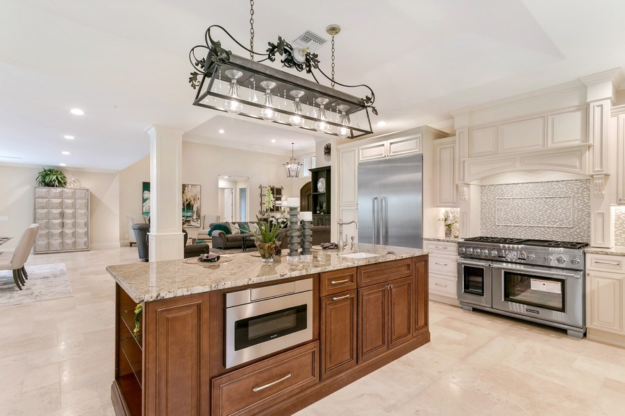 Real Estate Photography - 6840 SE South Marina Way, Stuart, FL, 34996 - Chef's Island With Sink