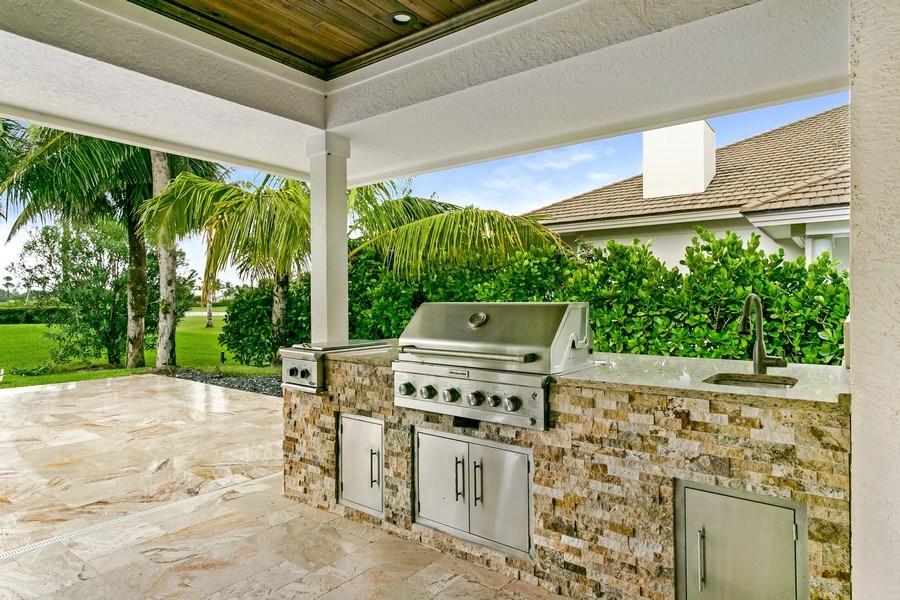 Real Estate Photography - 6840 SE South Marina Way, Stuart, FL, 34996 - Outdoor Kitchen