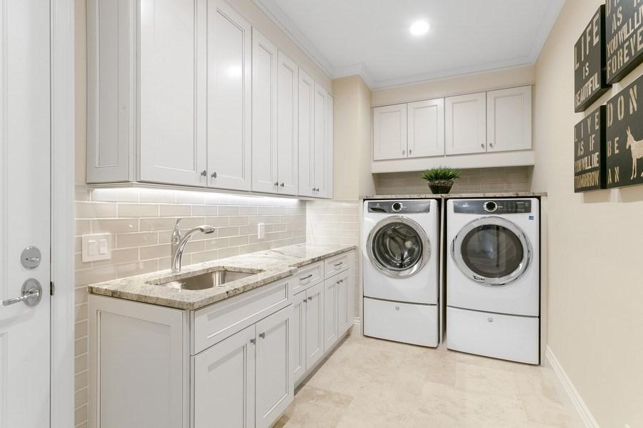 Real Estate Photography - 6840 SE South Marina Way, Stuart, FL, 34996 - Laundry Room