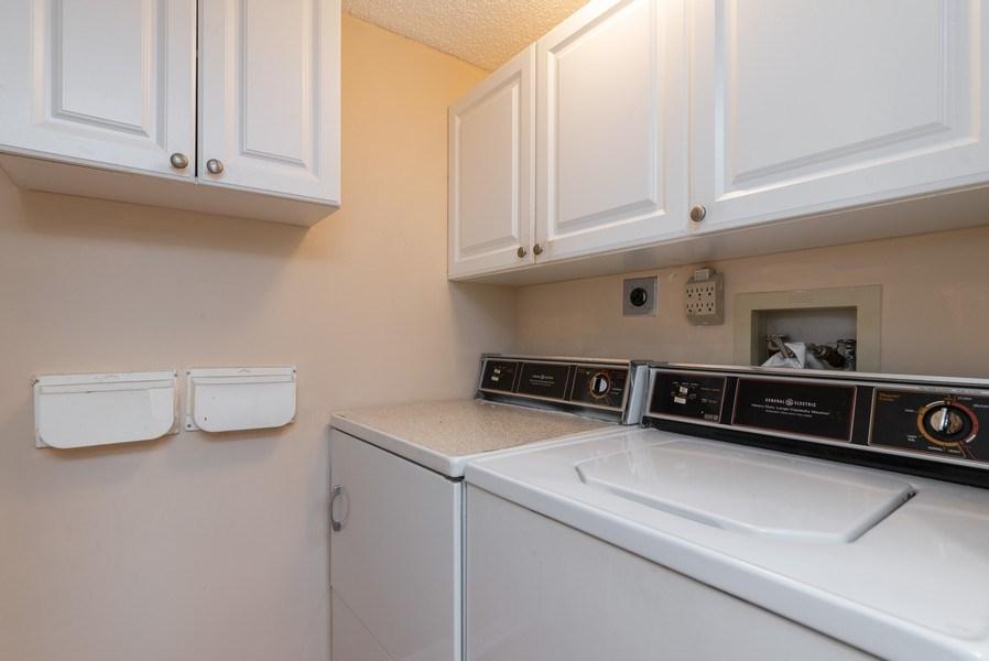 Real Estate Photography - 7310 Ashford Place, Apt 407, Delray Beach, FL, 33446 - Laundry Room