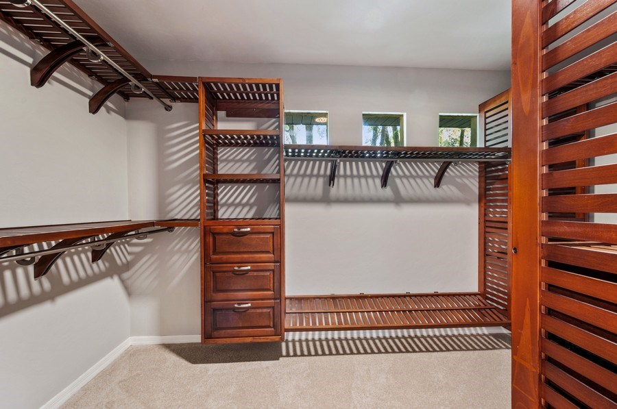 Real Estate Photography - 1917 SW 86th Terrace, Gainesville, FL, 32608 - Master Bedroom Closet