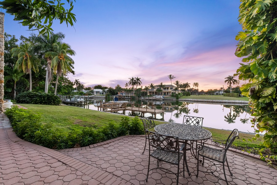 Real Estate Photography - 3220 Rum Row, Naples, FL, 34102 - View from back to Hidden Bay