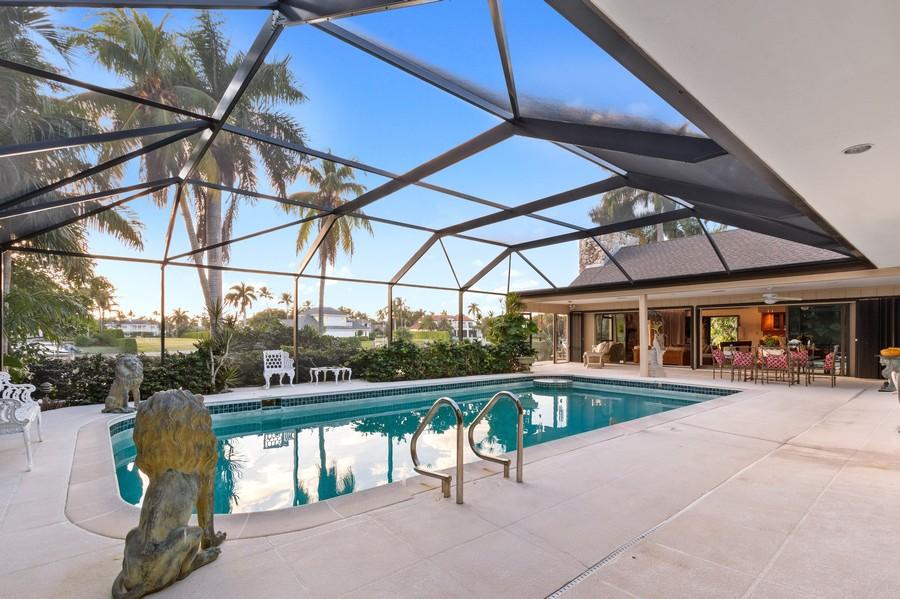 Real Estate Photography - 3220 Rum Row, Naples, FL, 34102 - Pool and Lanai