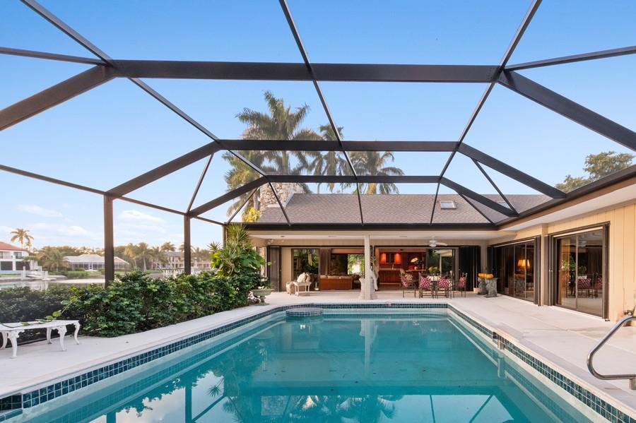 Real Estate Photography - 3220 Rum Row, Naples, FL, 34102 - Pool-Lanai-Great Room