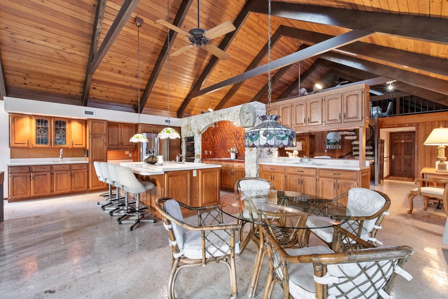 Real Estate Photography - 3220 Rum Row, Naples, FL, 34102 - Kitchen to Den and Loft
